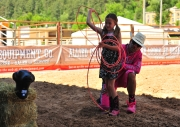 Matt Merritt instsructs a little girl on how to swing a rope at the shriners kiddie rodeo at the Tour Pro Division PBR in Deadwood SD.  Photo by Josh Homer.  Photo credit must be given on all uses.